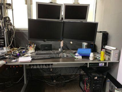 Ikea table with four monitor