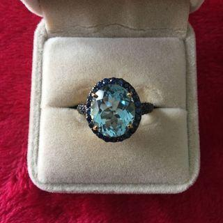 Blue topaz with blue sapphire ring
