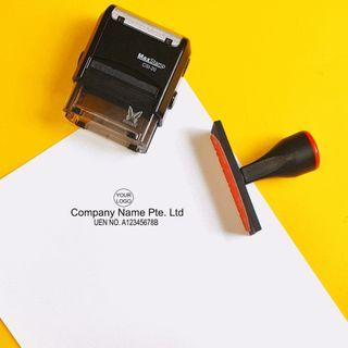 small self-inking company stamp