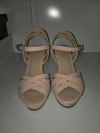 Strappy nude platform heels