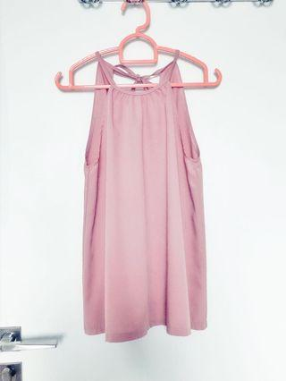 Pink sleeveless top with ribbon