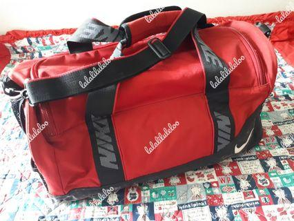 NIKE red traveling/fitness bag