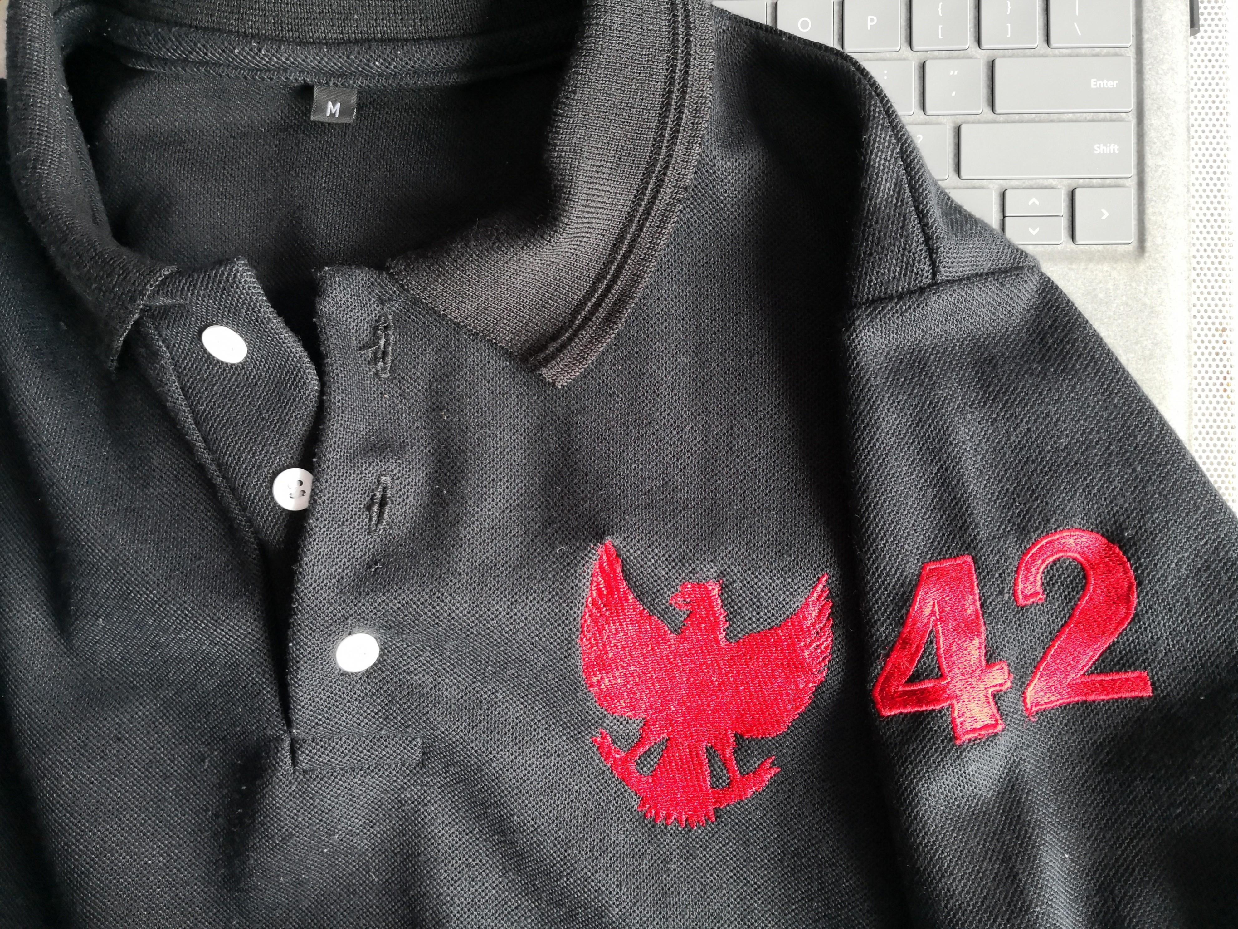Cool Garuda logo polo tee