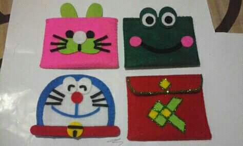 Kerajinan tangan angpao lebaran karakter anak dari kain flanel