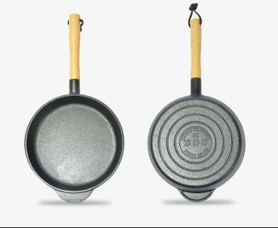 Cast iron pan with wooden handle