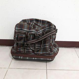 四輪行李包包