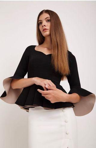 VGY Ansel Fluted Sleeve Peplum Top in Black