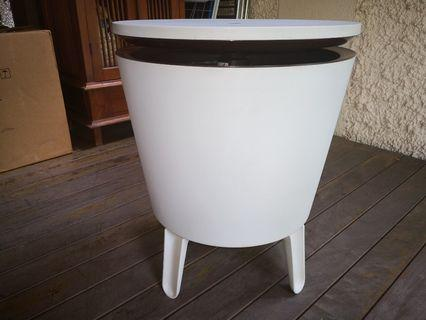 Patio table with built-in ice - bucket
