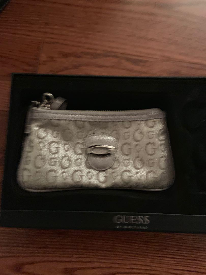 Brand new shiny guess wristlet.  Good to take out during the evening
