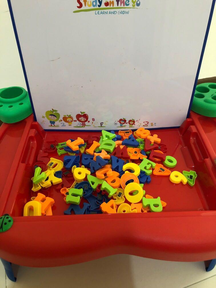 Learning table with magnet alphabet