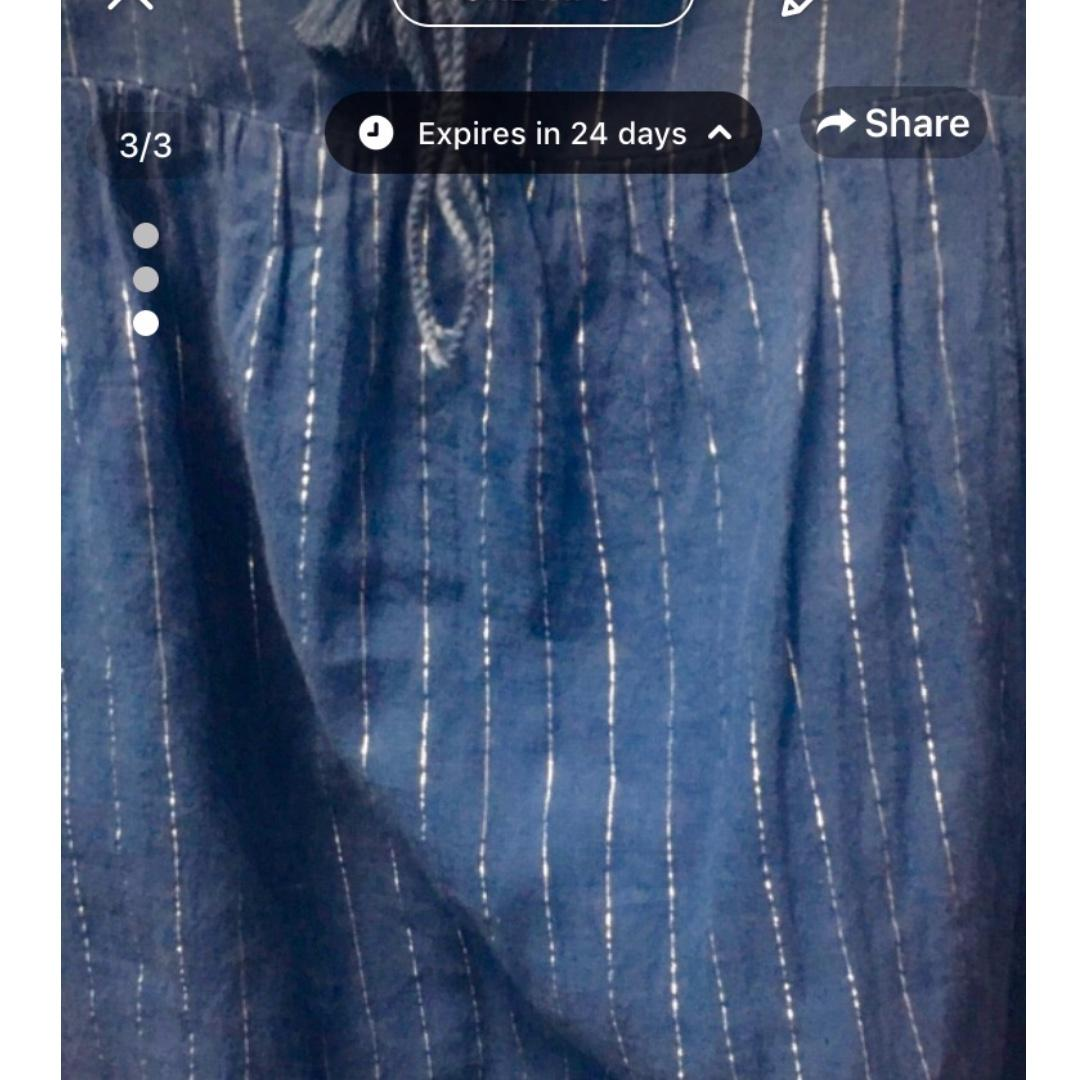 Very lightly used (3-4 times) Blue and Silver Striped Flutter Shirt- Size Small