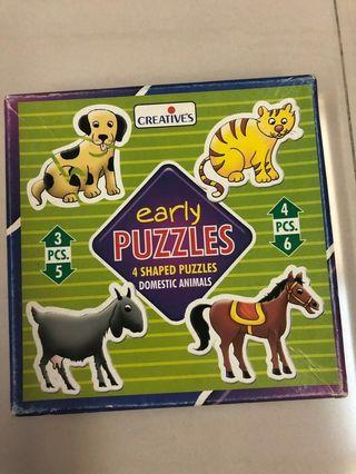 Puzzles (4 shaped puzzles domestic animals)