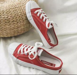 New red slip on sneakers