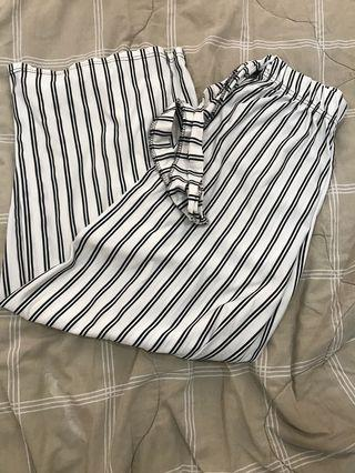 Black and white striped wide legged pants