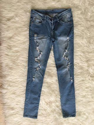 Channel blue ripped skinny jeans