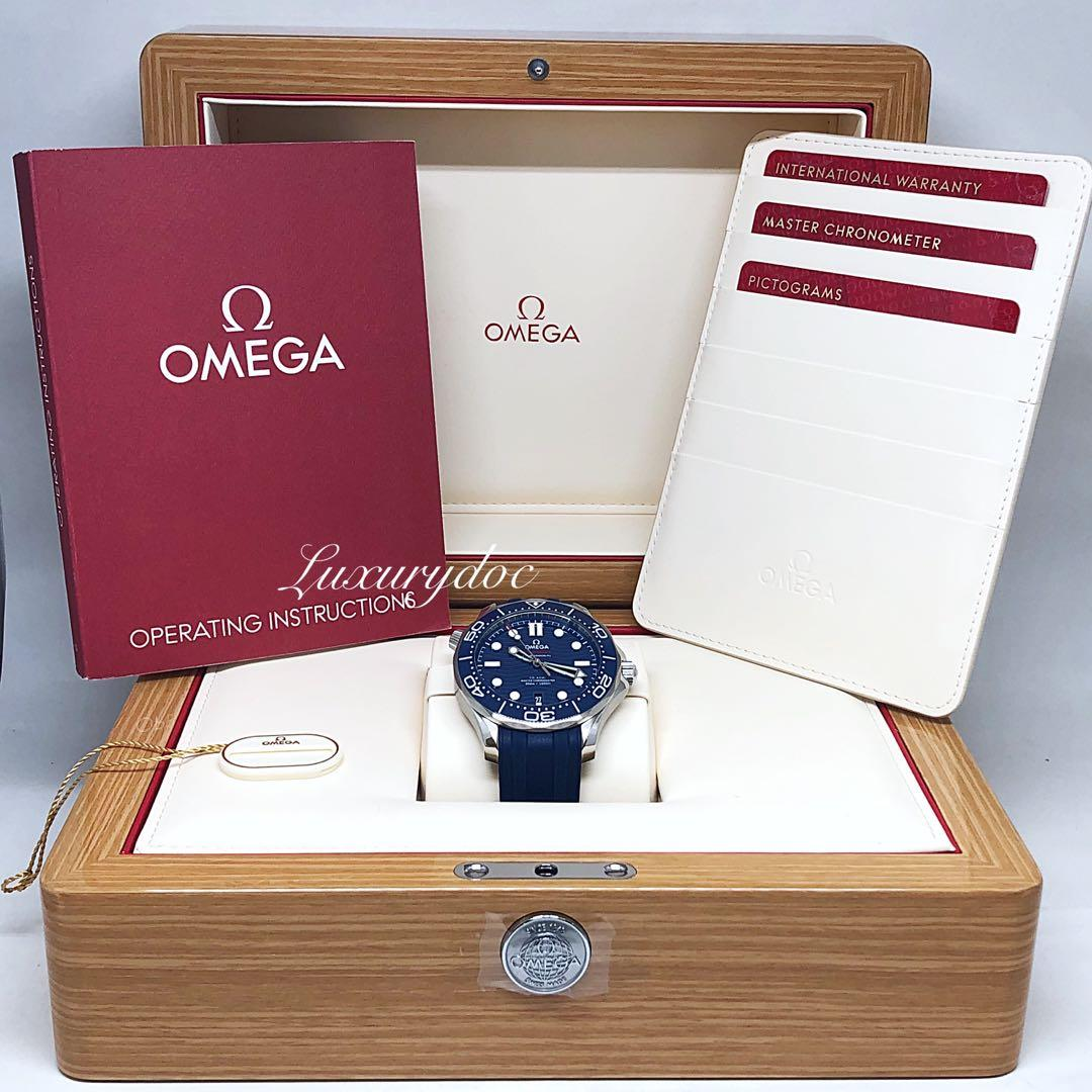 FS.BNIB OMEGA SEAMASTER DIVER 300M CO-AXIAL MASTER CHRONOMETER BLUE DIAL CERAMIC BEZEL ON BLUE RUBBER STRAP AUTOMATIC 42MM WATCH 210.32.42.20.03.001