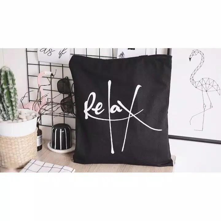 relax black tote bag