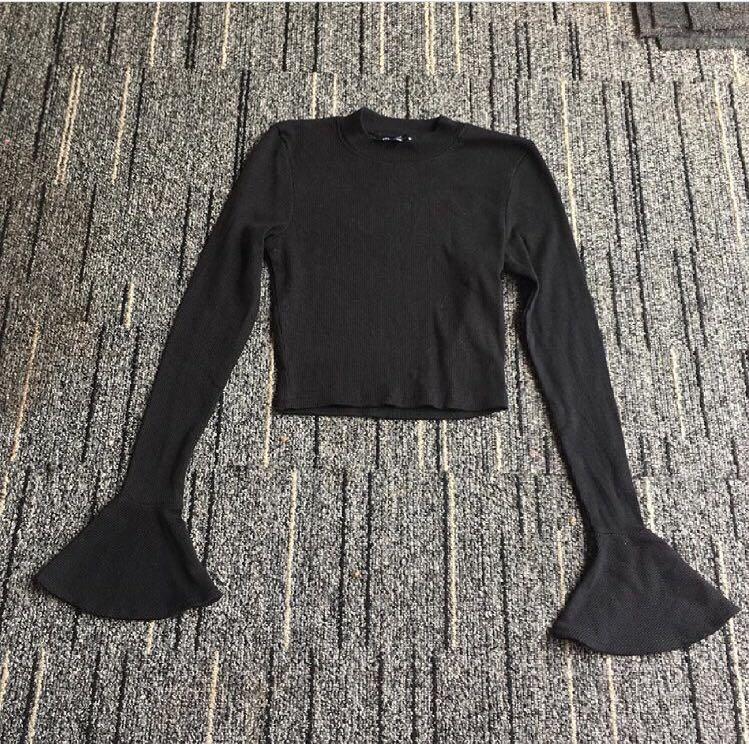 Top black terompet