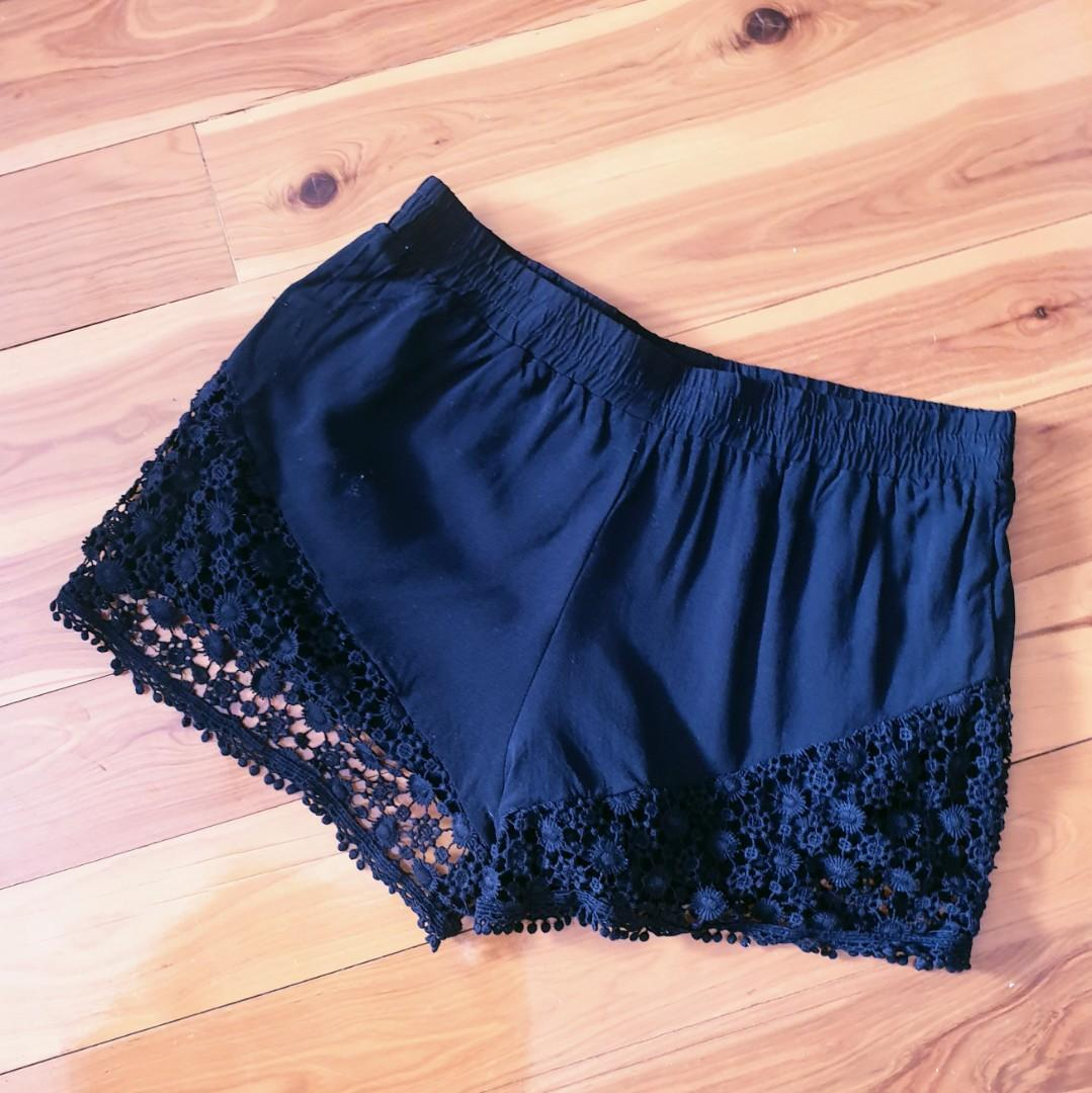 Women's size XS 'URBAN ANGEL' Gorgeous black shorts with crotchet detail - AS NEW