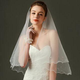 White bridal veil with curvy edge