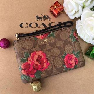 AUTHENTIC COACH CORNER ZIP WRISTLET IN SIGNATURE CANVAS WITH JUMBO FLORAL PRINT