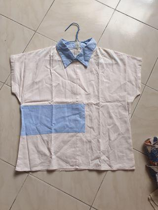 White shirt with blue accent