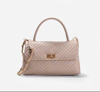 Christy Ng (Felix warm taupe quilted)
