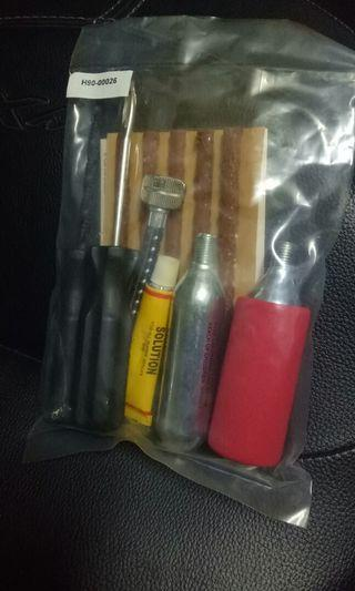 Tire repair kit with cO2 cylinder