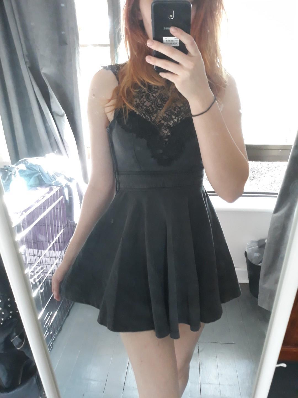 Gothic / alternative. Dark grey, tight fitting, short dress.