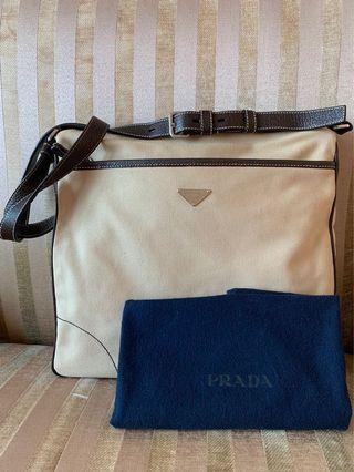 Prada calf leather and canvas messenger / cross body bag