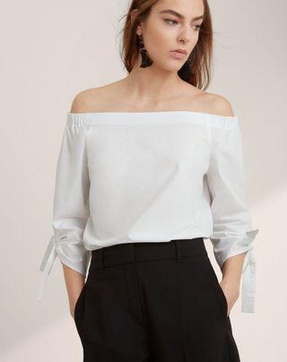 Aritzia, Malik blouse