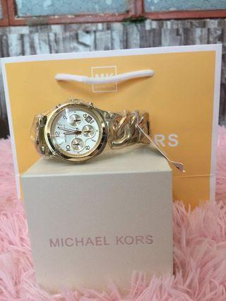 Original MK TWISTED watch PAWNABLE  medium face for women