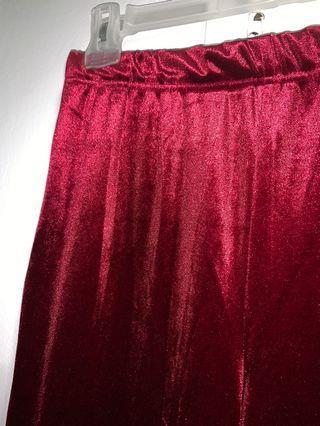Red velvet flared pants