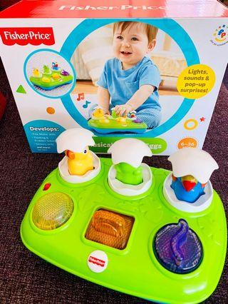 Expat Family selling FISHER PRICE Musical Pop-Up Eggs Toy