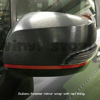 Subaru forester mirror wrap with red lining.