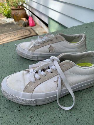 Tan and white converse one star