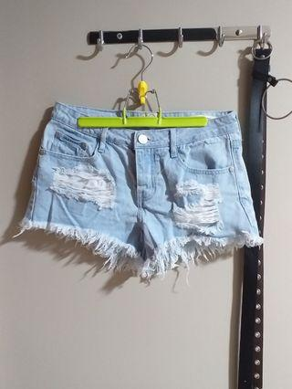 ripped denim mid waisted shorts
