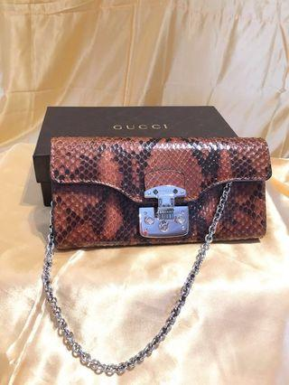 Brand New Gucci Python clutch with silver tone chain