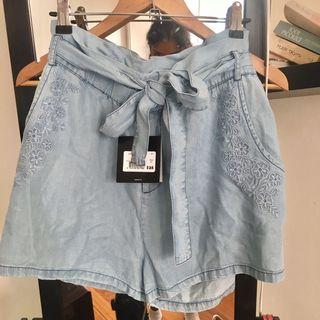 Light blue embroidered paperbag shorts