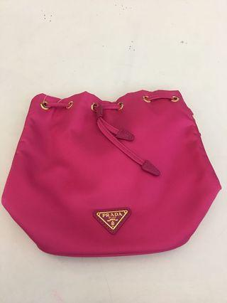 Prada pink nylon bucket wristlet come with authenticity card