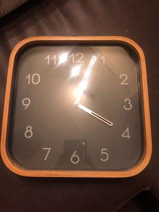 Wall clock with wooden frame