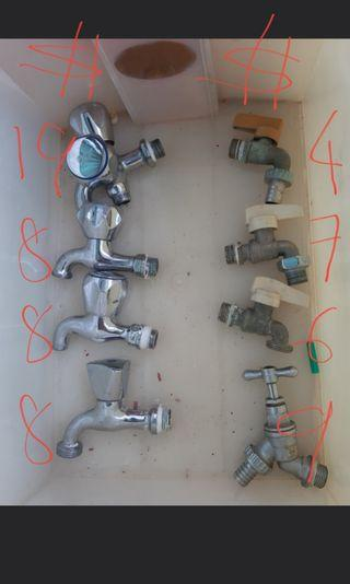 Assorted single and dual control taps .also water machine taps