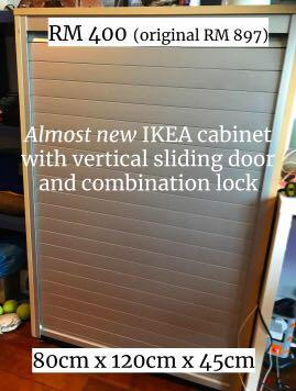 Cabinet with sliding door and lock