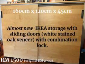 Sliding door storage cabinet with lock