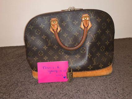 Louis Vuitton Alma Monogram Cloth Bag