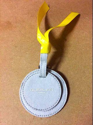 Guerlain luggage / name tag