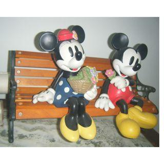 Mickey and Minnie Mouse figurine on bench