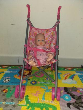 Baby doll in toy stroller
