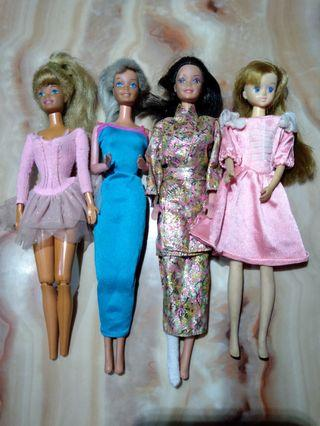 Vintage Barbie and Kelly dolls with accessories