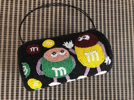 Whimsical beaded bag with M&M characters